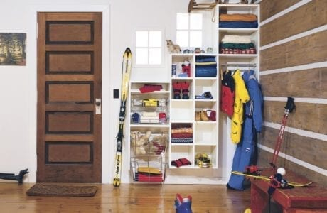 Tiered White Built in Shelving Cubbies and Baskets