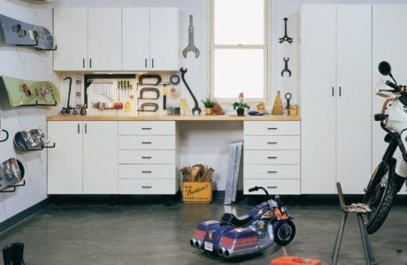 White Garage Storage with Cabinets Drawers Tool Rack Sowboard Rack and Light Wood Topped Workspace