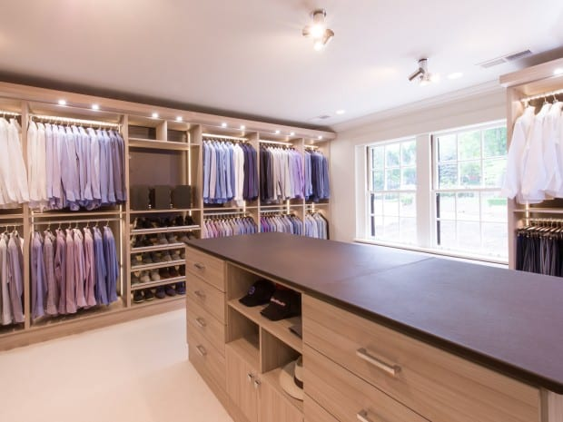 Natural Wood Walk in Closet with Closet Rods Drawers Cabinets Shoe Racks Vanity Mirror and Built in Lighting