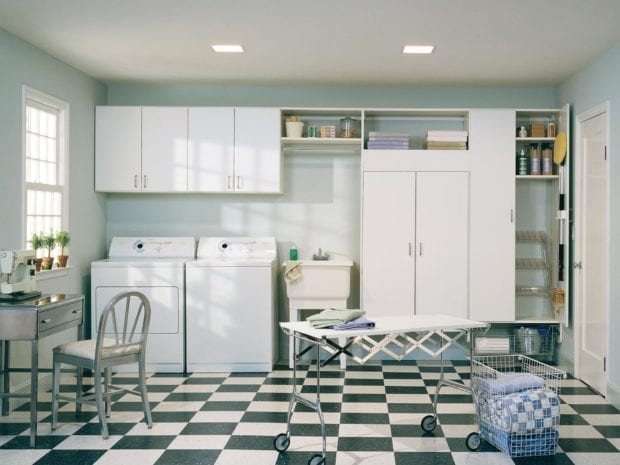 Laguna laundry room with white cabinets