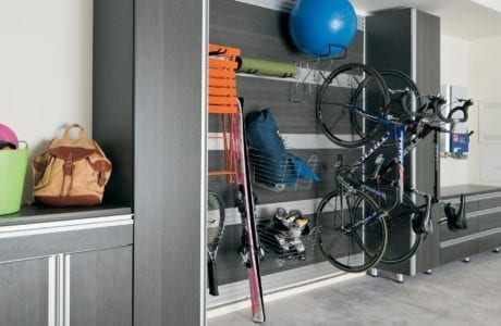 Grey Themed Garage Storage with Drawers Cabinets Hanging Racks and Metal Accents