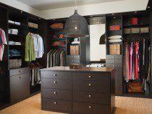 Dark Brown Walk in Closet with Cabinets Shelves Vanity Mirror and Built in Lighting
