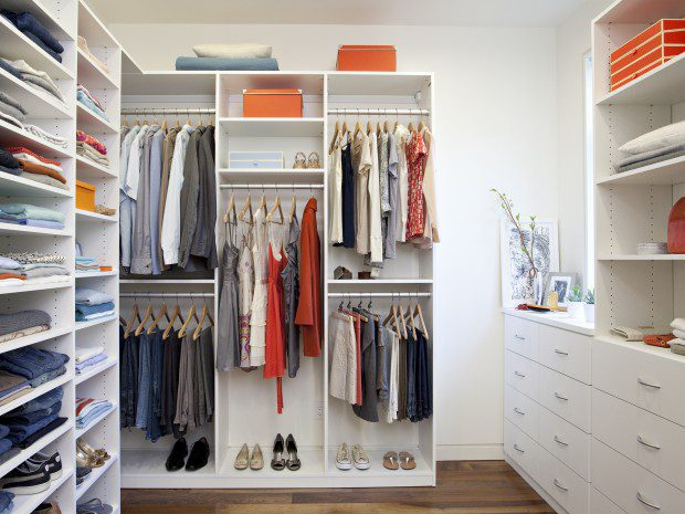 White Themed Walk in Closet with Drawers Shelving and Closet Rods