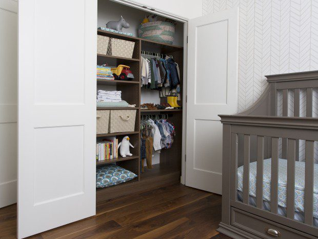 Dark Brown Reach In Children's Closet With Shelving Baskets and Closet Rods