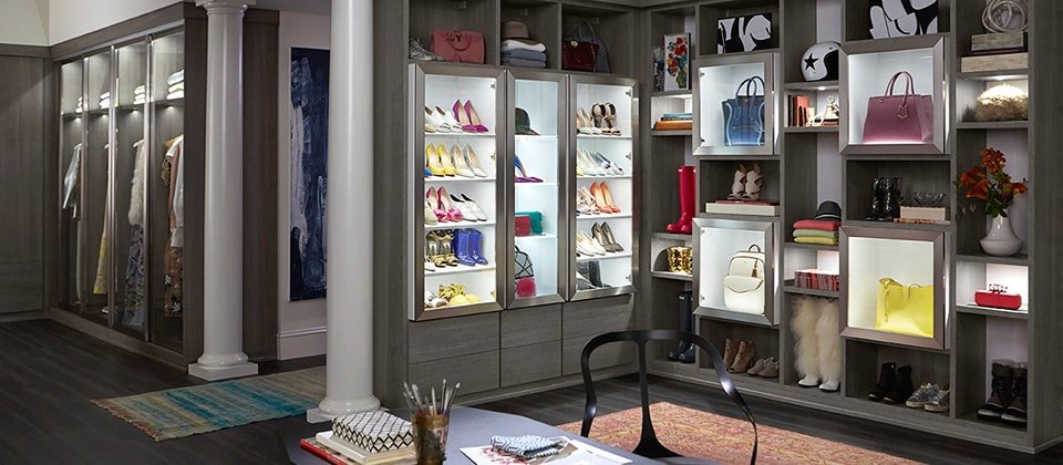 Grey Themed Walk in Closet with Shelving Drawers and Lighted Display Cabinets