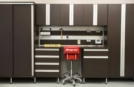 Dark Brown Garage Storage With Tool Rack Cabinets Drawers Work Space and Metal Handles