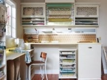 Beige and Yellow Craft Room with Shelving Cubbies Decrotive Inlay Cabinets Tool and Paper Racks and Work Spaces