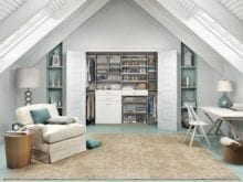 White and Turquoise Themed Attic Reach in Closet With Shelves Drawers Closet Rods and Built in Baskets