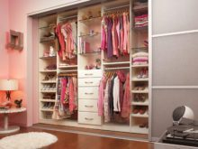 Pink Backed Children's Reach in Closet with White Shelves Closet Rods and Drawers and Ligh Grey Aluminum Sliding Doors