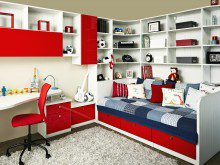 White Themed Kids Room with Built in Bed Desk Shelves and High Gloss Red Fronted Cabinets and Drawers