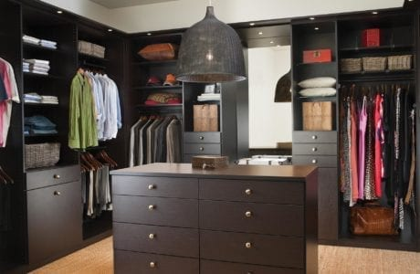 Dark Brown Walk in Closet with Shelving Drawers Built in Lighting Vanity Mirror and Stand Alone Dresser