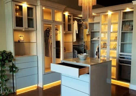 Showroom Interior Light Grey Wood Grain Walk In Closet with Lighted Display Shelves High Gloss Drawers and Stand Alone High Gloss Dresser
