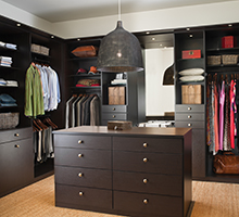 Dark Wood walk in Closet With Shelving Closet Rods Drawers and Stand Alone Dresser