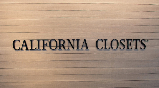 California Closets lettering on wooden panel backing