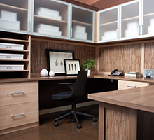Light Wood Office Space with Wrap Around Desk Shelving Drawers and Cabinets with Frosted Glass Doors with White Trim