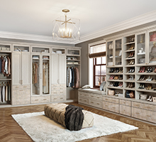 California Closets designed walk in closet with light Adriatic finish and bronze hardware
