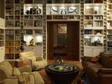 Large White Family Room Storage With Cubbies Shelving Cabinets and Built in Lighting