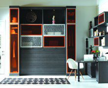 Dark Wood Office Space with Cabinets Desk Floating Shelves Orange Display Doors and Murphy Bed