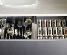 Close Up of Grey Kitchen Drawers with Flatware and Spice Organizers
