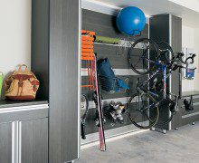 California Closets Dark Grey Garage Storage With Wall Hooks Closet Cabinets Drawers and Metal Accents