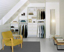 Tiered White Reach in Closet With Shelving Drawers and Metal Closet Rods