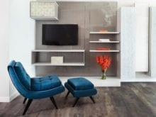 Entertainment Center With High Gloss Grey Backing Light Grey Floating Cabinets and Shelves and Texture Accent Pannels
