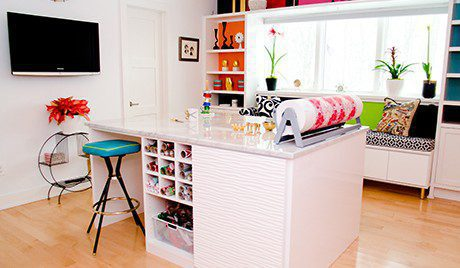 Colorful Craft Room with White High Gloss Shelving Cabinets Built in Window Seating and Stand Alone Workspace