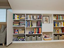 White Library Shelving with Grey Baskets