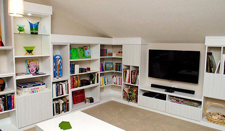Redesigned Loft Space with White Shelving Cabinets Entertainment Center Built in Lighting and High Gloss Coffee Table