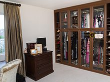 California Closets Client Stories Gallery Dark Brown Wardrobe with Glass Doors