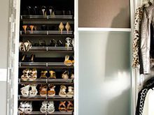 Close Up of Dark Brown Shoe Rack Shelving With White Trim
