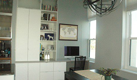 Office Nook with White shelving Drawers Cabinets and Grey Topped Built in Desk