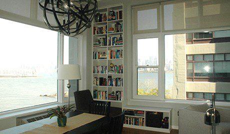 Built In White Book Shelf in Near Apartment Bay Windows