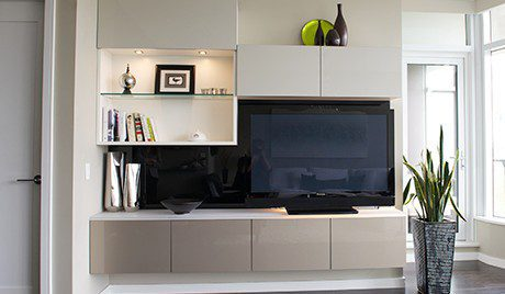 Entertainment Center With Black Backing White Shelving and Cabinets and Grey High Glass Accent Cabinets