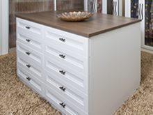 Close Up of Walk in Closet White Stand Alone Dresser with Dark Brown Wood Grain Top
