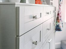 Close Up of White Dresser Drawers