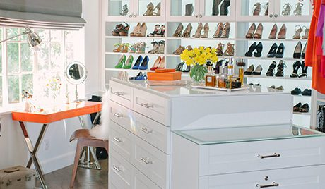 White High Gloss Walk in Closet with Shelving Cabinets With Glass Doors Tiered Stand Alone Dresser and Orange Vanity Desk