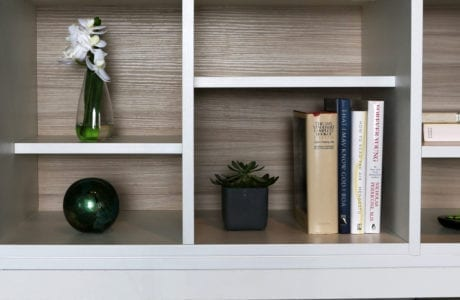 Close Up of White Shelving with Light Wood Grain Backing