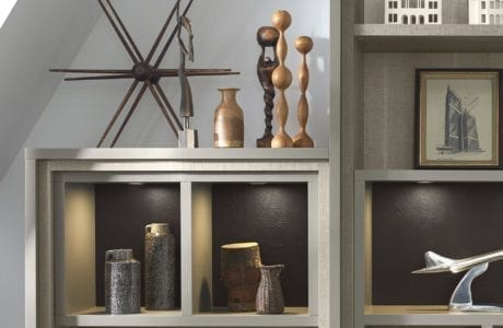Close Up image of Grey Home Shelving with Two Layers of Recessed Trim and Built in Lighting