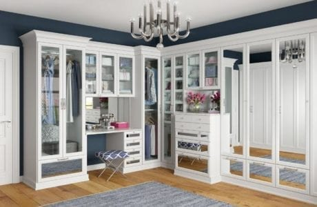 Glamorous white walk in closet with mirror insert door and drawer styles by California Closets