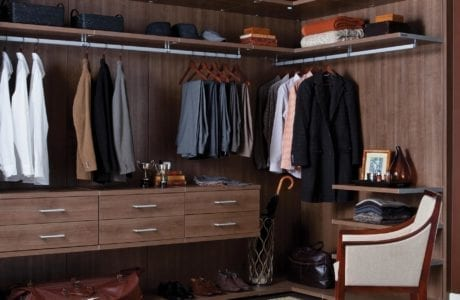 Dark Brown Wood Grain Walk in Closet with Drawers Shelves Metal Accents and Closet Rods