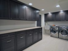 Hoboken laundry room with dark gray cabinets
