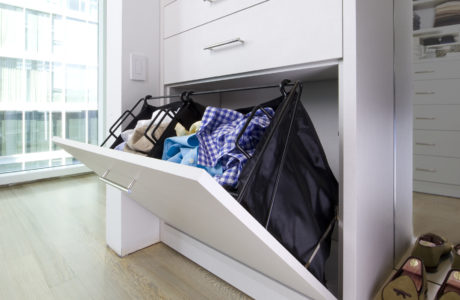 Close Up of White Built in Dresser with Fold Down Drawer and Metal Baskets