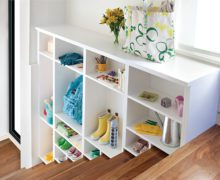 White Tiered Staircase Storage With Shelves and Cubbies