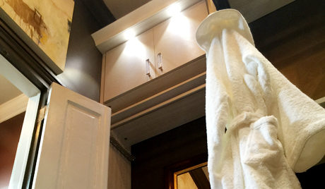 Close Up Image of walk in Closet Cabinets and Hanging Hooks
