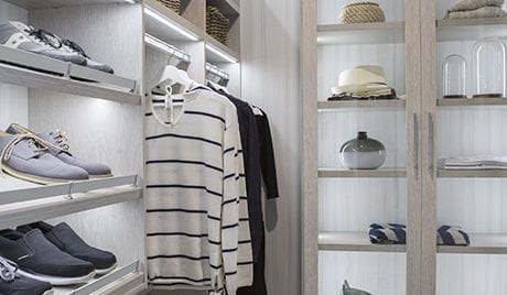 Close Up Image of Walk in Closet with Grey Shelving Shoe Racks Closet Rods and Display Shelves