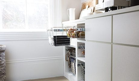 Client Story Apt 34 Bellissima White Cabinets with Nickel Wire Storage Baskets
