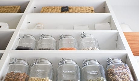 Close up Image of White Pantry Shelving With Mason Jars