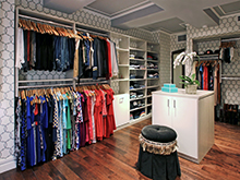 Liberte Chan Client Story Large Walk In Closet with White Center Table and Hanging Racks