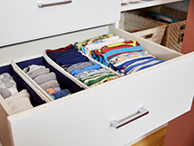 Sophie Donelson Client Story Large Pull out White Drawers with Polished Metal Hardware